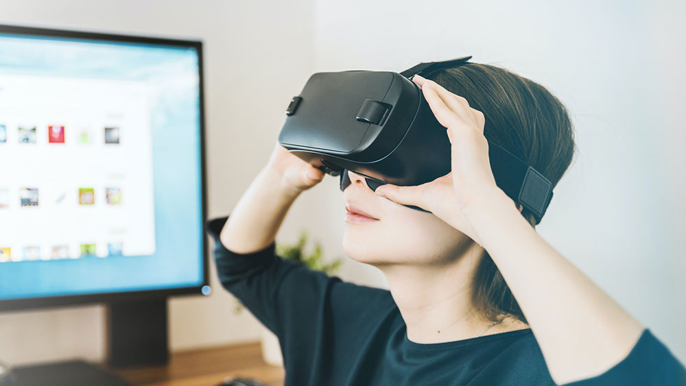 Young woman using VR headset
